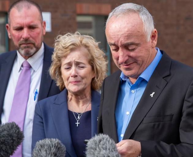 David and Gillian Millane, accompanied by Detective Inspector Scott Beard (L), speak to media...