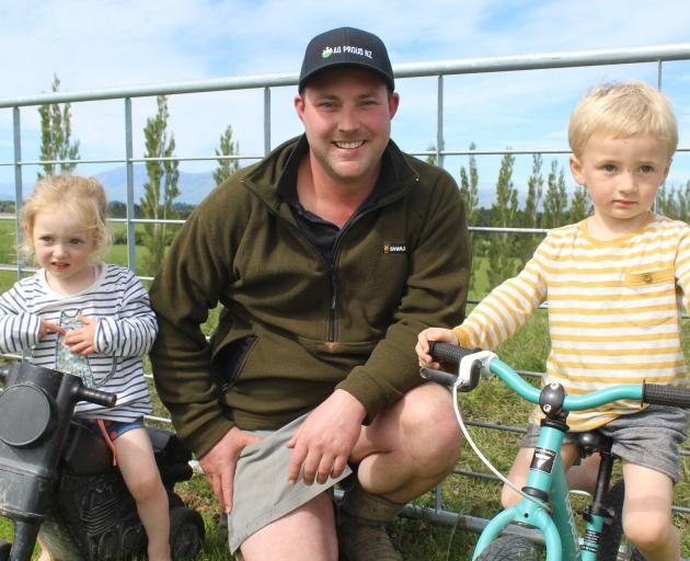 Mossburn dairy farmer and AG Proud founder Jason Checketts with his children Adelaide (2) and Liam (3). Photo: Abbey Palmer