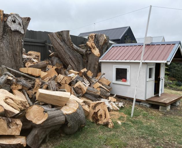 Firewood and a playhouse was part of the deal when a Waikuku Beach bach changed hands. Photo:...