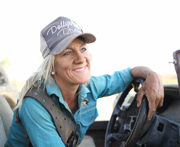 Liz Cook, pictured at the wheel of her bull-catcher, reflects on life in the Australian outback....