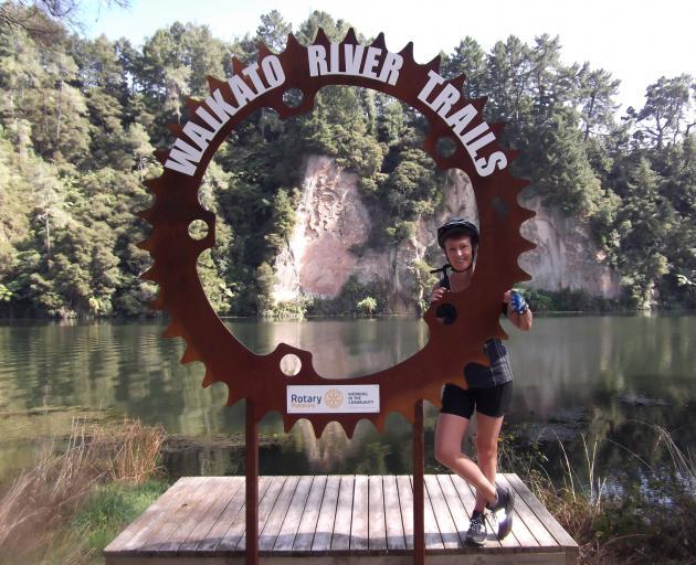 A quick stop at the Waikato River Trails sign at Lake Karapiro.