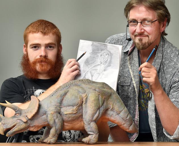University of Otago geology and paleontology student Shane Meekin (left) gets advice on how to...