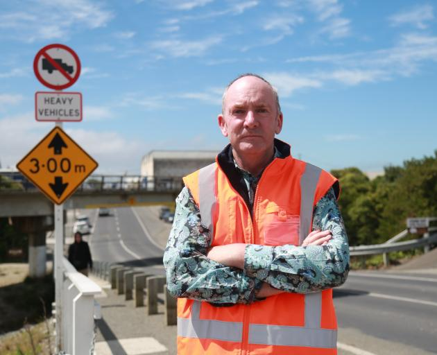 Waitaki District Council roading manager Mike Harrison stands by the new signs installed in...