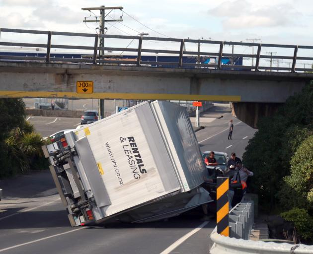The truck rolled onto a passing vehicle in Humber St, under the overbridge. Photo: Rebecca Ryan