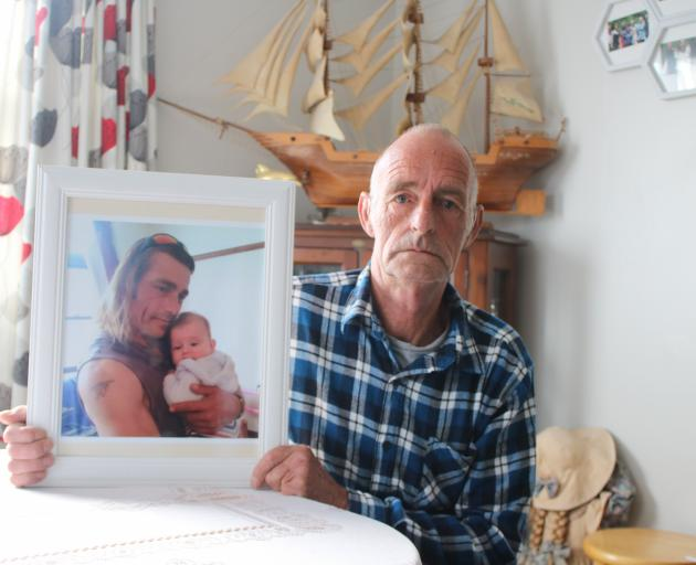 Bruce Cawley holds a photo of his stepson, Craig Andrews, who was flown to Dunedin Hospital in a...