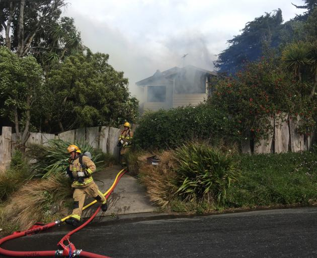 Firefighters at a major house fire on Beaconsfield Rd in Portobello. Photo: Gerard O'Brien