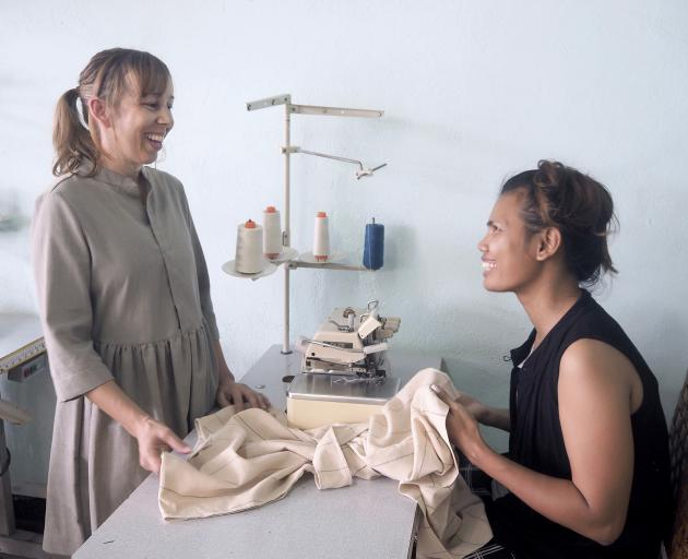 Founder and business director Erica Gadsby (left) visits Srey Leak, manager at ReCreate's sewing...