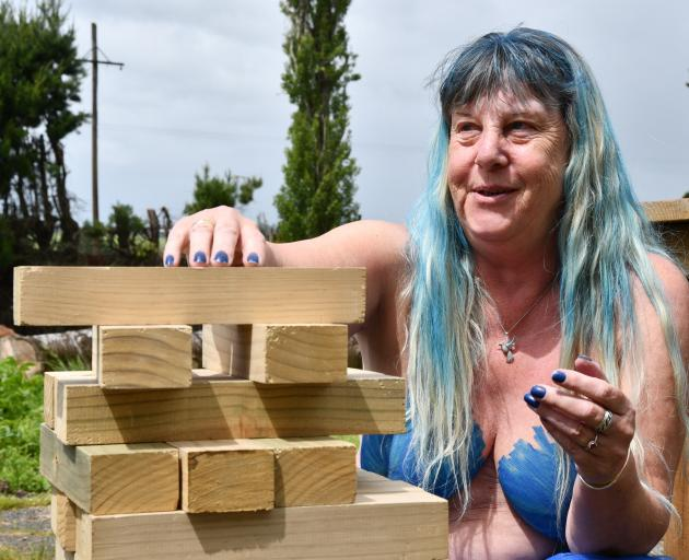 Southern Naturally member Wilma Kremer had a go with the giant Jenga during a break in the rain....