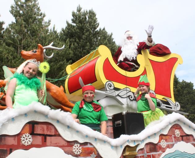 Santa Claus (Stewart Saunders) and his helpers [from left] Ave Valoa-Jack (9), Georgia McWing (10...