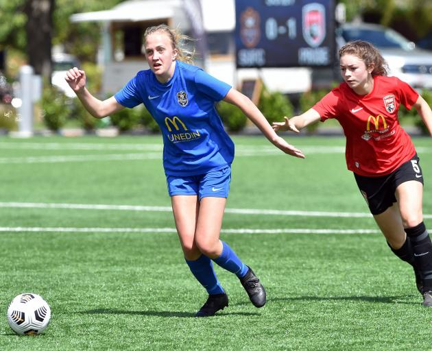 Southern United forward Emily Morrison and Canterbury Pride's Makaela Hunt chase the ball during...