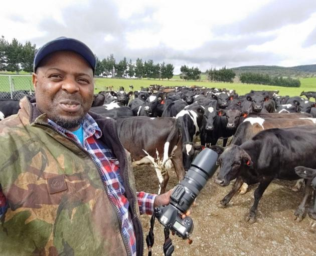 Edwin Mabonga, of Otautau, combines his two passions, dairy farming and photography. PHOTO: EDWIN...