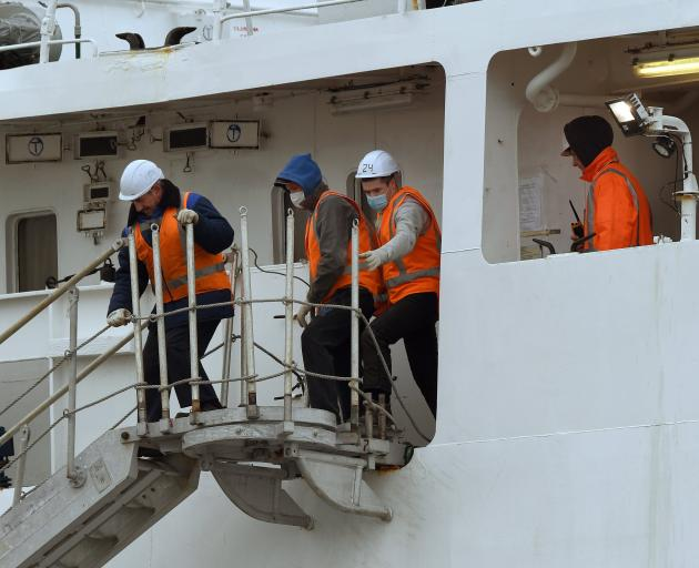 Sailors prepare the Te Raukura for departure in Dunedin yesterday. PHOTO: STEPHEN JAQUIERY