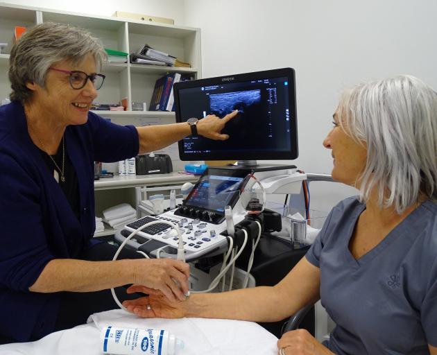 Wanaka sonographer Jill Muirhead demonstrates the latest ultrasound technology to radiographer...