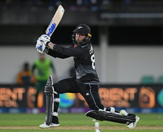 New Zealand batsman Devon Conway hits the ball firmly square of the wicket during his innings of...