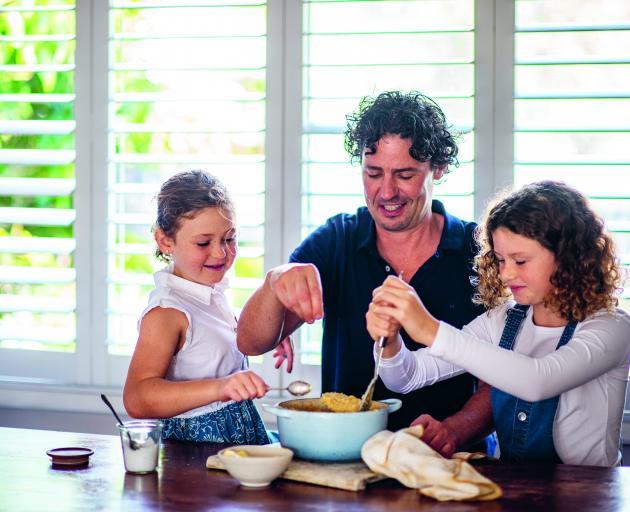 Irish-born Australian chef Colin Fassnidge prepares a meal with his  daughters. PHOTOS: ALAN BENSON