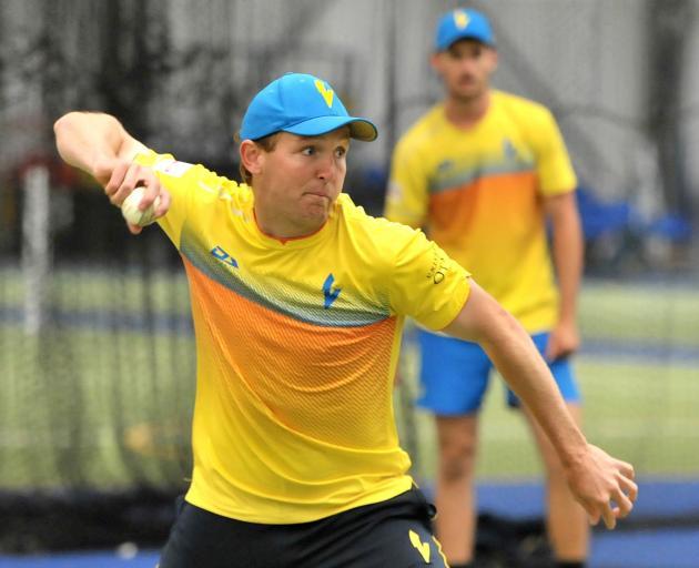 Otago seamer Angus McKenzie returns the ball during a training session at the Edgar Centre...