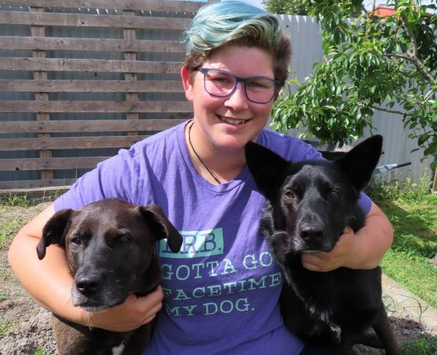 Dog trainer Mady Bensdorp with canine buddies Dusty (left) and Cas. Photo: Supplied