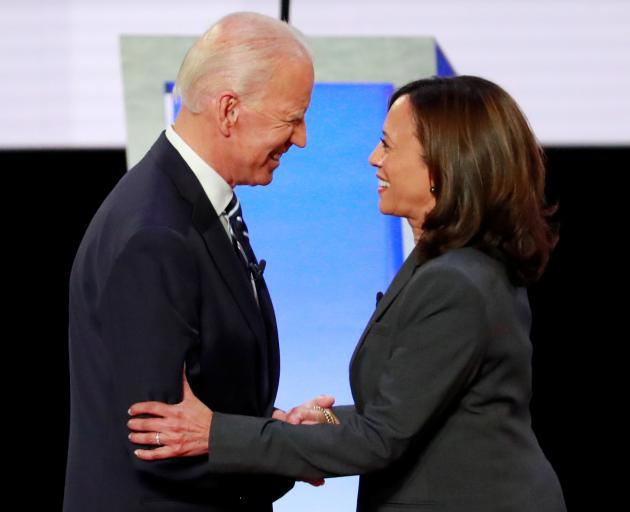Former Vice President Biden and Senator Harris shake hands before the start of the second night of the second U.S. 2020 presidential Democratic candidates debate in Detroit. Photo: Reuters