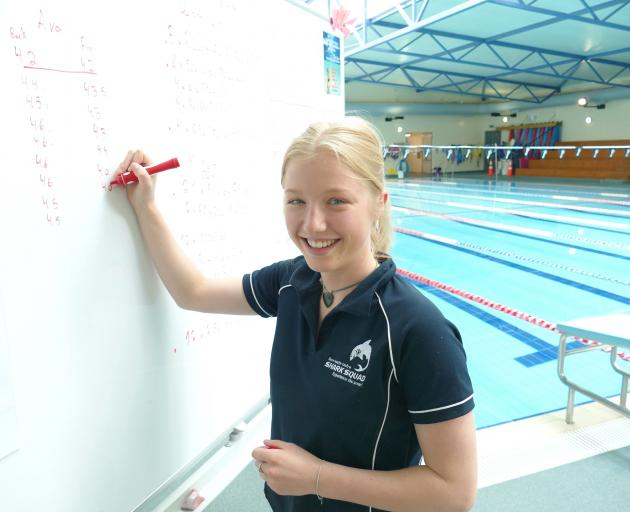 High-achieving Gore teenager Natalia Hamilton prepares to coach young swimmers at the town's...