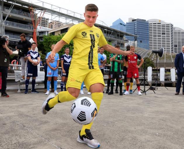 The Wellington Phoenix's Cameron Devlin kicks a ball at the A League's season launch at Darling...