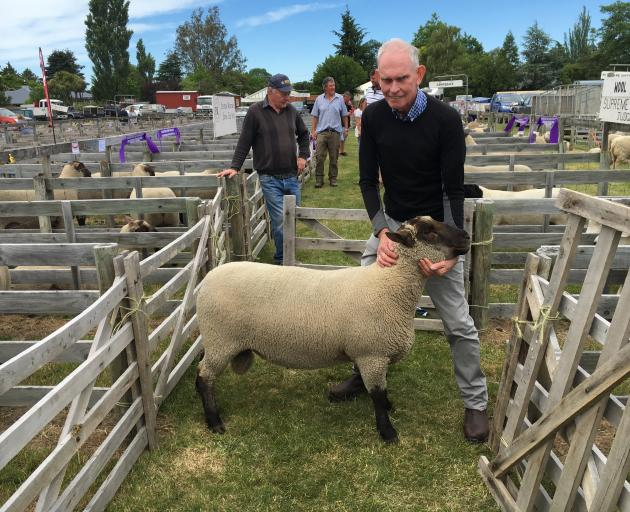 Ashburton farmer Stuart Sinclair bowed out in style, winning supreme champion ram hogget at his...