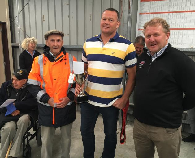 Marlborough farmers Ali (left) and Stu Campbell (centre) are congratulated by the sponsor South...