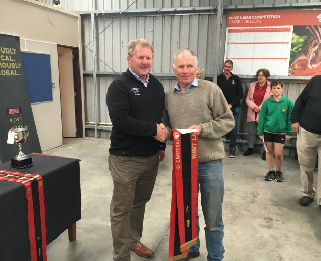 Ashburton farmer Paul Gardner (right) is congratulated by South Pacific Meats' South Island...