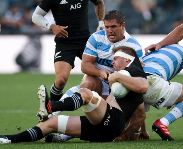 All Black skipper Sam Cane is tackled by Argentina's Francisco Gomez Kodela in the Pumas'...