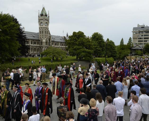 University of Otago graduands and staff march through the university grounds on Saturday. PHOTO:...