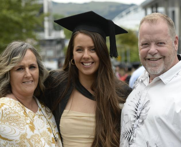 Karilyn Cribb and Andrew Williams, of Nelson, celebrate the graduation of their daughter Ferne...
