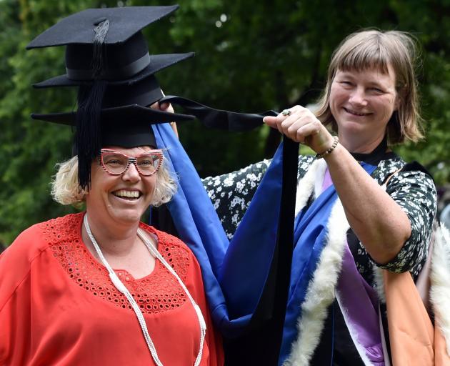 Federation of Graduate Women Otago branch academic regalia conveners Andrea Warburton (left) and...