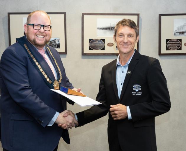 Waimakariri Mayor Dan Gordon (left) presents Northern Bulldogs Rugby League Club life member...