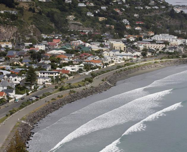 A report says coastal properties in suburbs like Sumner could face spiraling insurance premiums –...