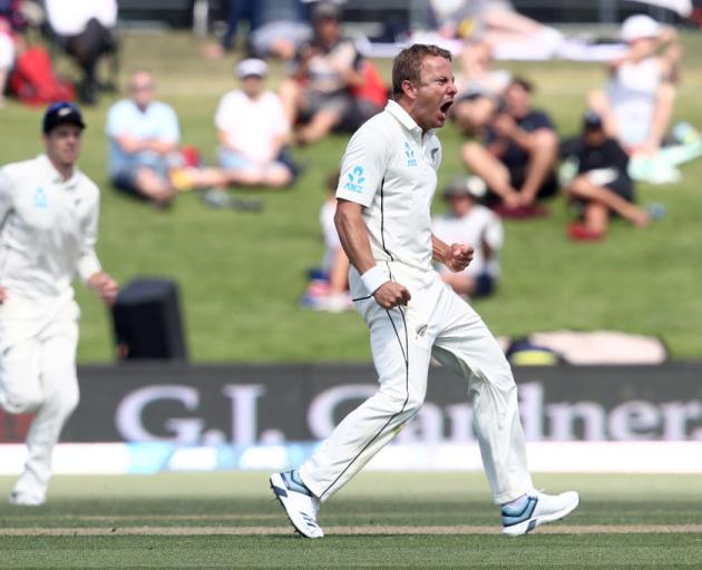 Neil Wagner of New Zealand celebrates his wicket of Joe Root of England. Photo: Getty Images