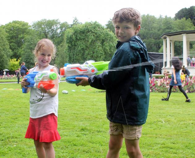 Melina (5) and Alexander Parven (7) were not worried about the rain and had a blast playing with...