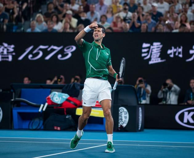 Novak Djokovic celebrates his semifinal win over Roger Federer at the Australian Open last night....