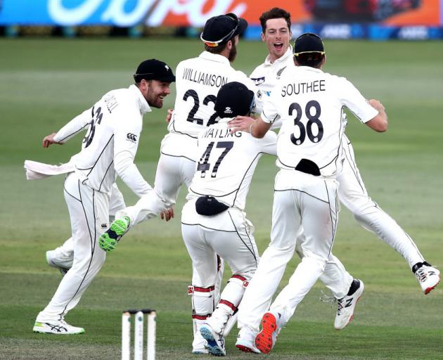 New Zealand celebrate the final wicket of Naseem Shah of Pakistan to win the match during day five of the First Test match in the series . Photo: Getty Images