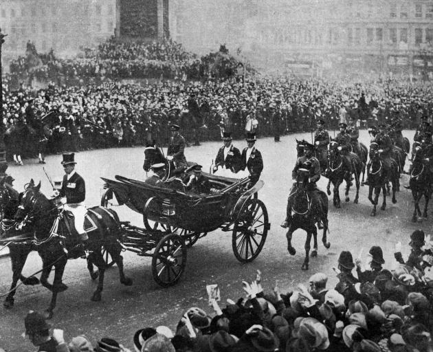David, Prince of Wales (later King Edward VIII) acknowledges the cheers of London crowds on his...