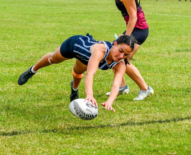 St Hilda's Collegiate School pupil Annie Timu dives for a try on day two of the New Zealand...