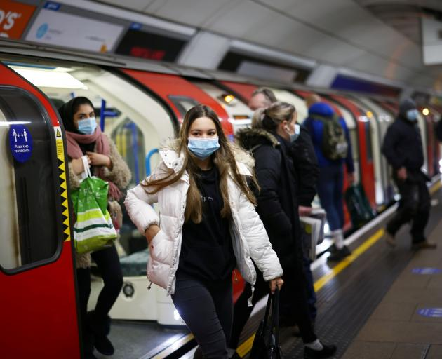 People leave a train at the Victoria tube station as Covid-19 rages in London this week. PHOTO:...