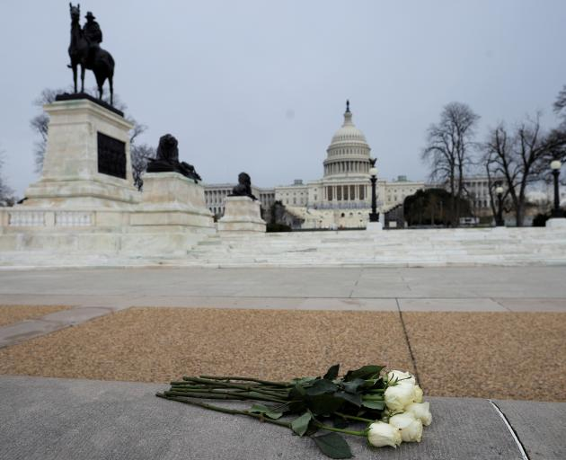 Flowers are placed near the U.S. Capitol in tribute to Capitol Police Officer Brian Sicknick. Photo: Reuters