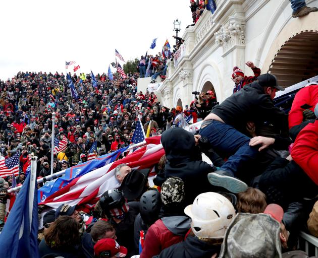Pro-Trump protesters storm into the US Capitol during clashes with police, during a rally to...