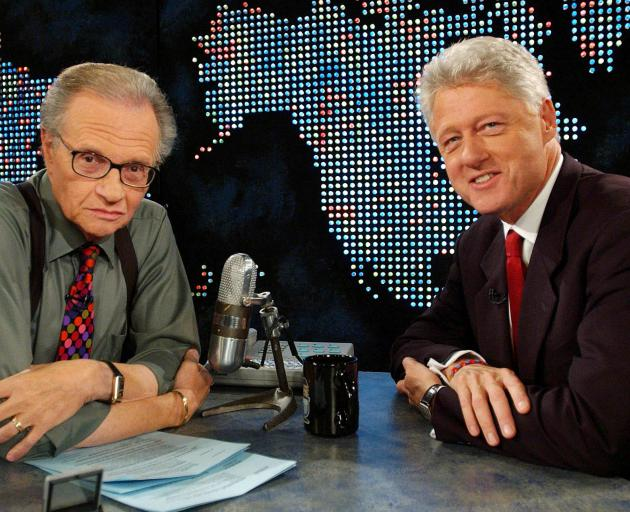 Larry King with former US President Bill Clinton in 2002. Photo: Reuters