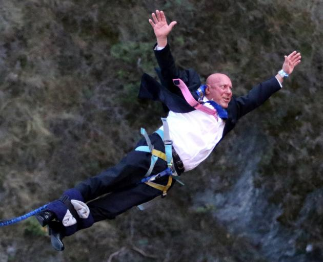 Queenstown Lakes Mayor Jim Boult signals the reopening of the district's tourism industry in June...