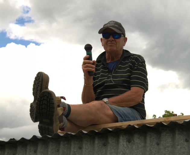 Larry Guthrie, of Lawrence, oversees and commentates on the day's proceedings from a spot he has...