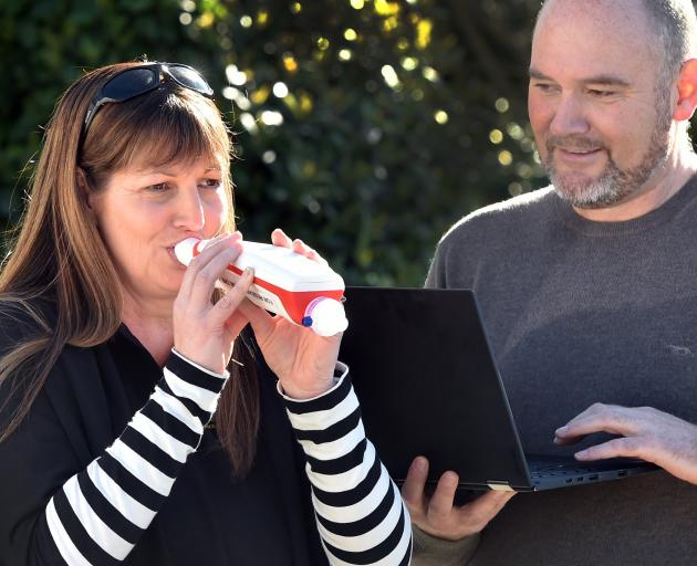 Jade Star Childcare and Learning Centre manager Amanda Dore tries a new Covid-19 breath analyser,...