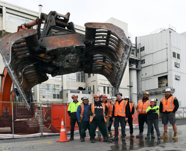New Dunedin Hospital build staff involved in a new course in demolition, alongside a 20-tonne...
