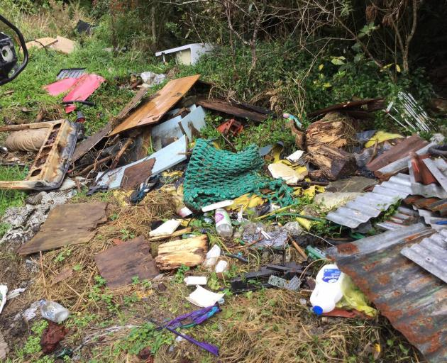 Rubbish dumped on Department of Conservation land at 8-Mile Valley near Rapahoe on the West Coast of the South Island picture. Photo / Doc