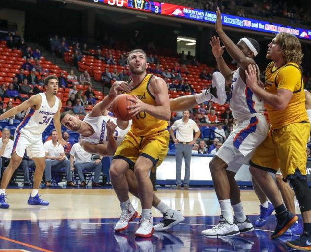 Geremy McKay prepares to go up with the ball while playing for Vanguard University against Boise...