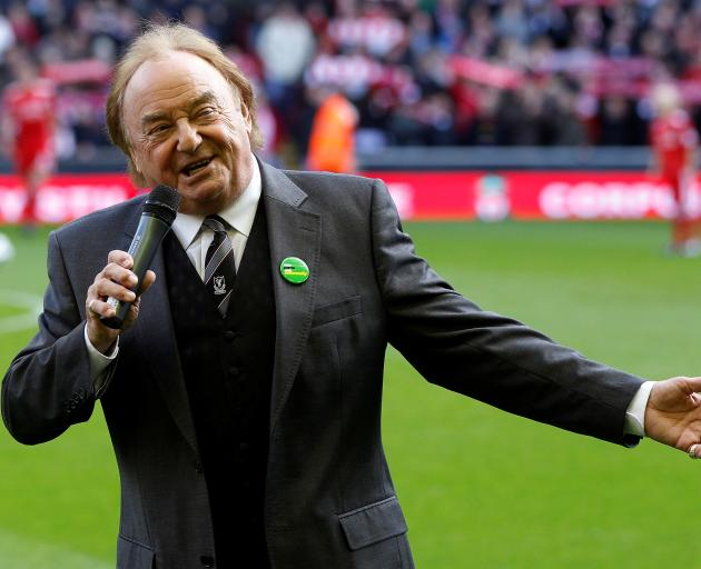 Liverpool supporter and singer Gerry Marsden sings You'll Never Walk Alone. Photo: Reuters
